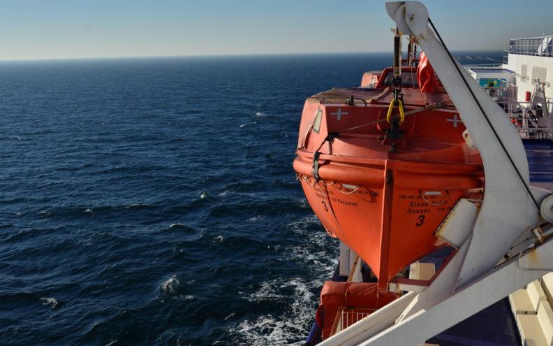 orange-and-white-ship-on-sea-3699183 1